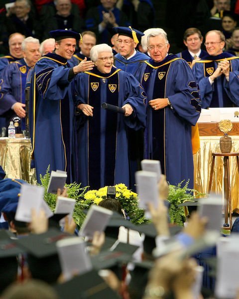 Matt Storin (far right) looks on as author Harper Lee receives an honorary degree in 2005, photo by Matt Cashore
