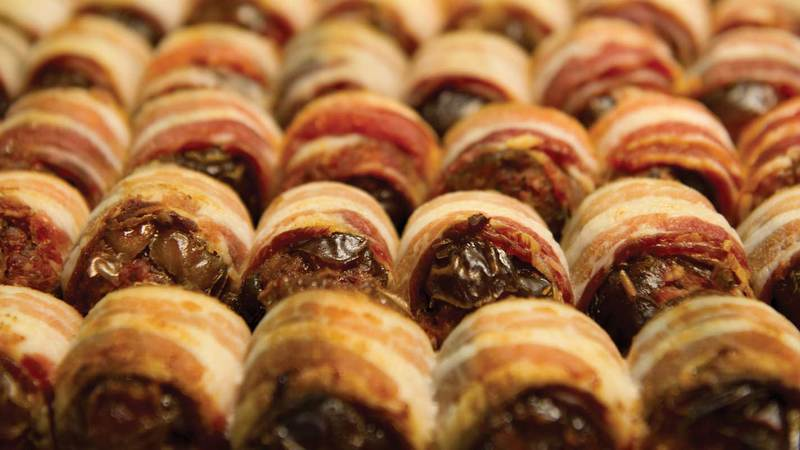 bacon-wrapped, chorizo-filled dates, photo by Barbara Johnston