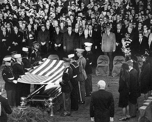 http://magazine.nd.edu/assets/118798/512px_honor_guard_prepares_to_fold_flag_over_jfk_casket_25_november_1963.jpg