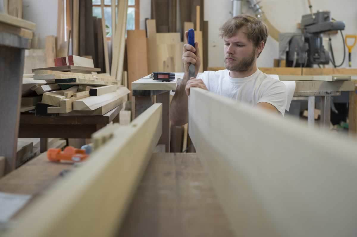 The newest member of the Fritts shop, Joe Green learned carpentry as a boatbuilder.