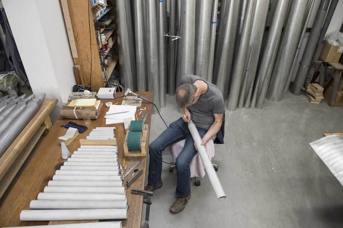 "McLeod and Greg Bahnsen might work on dozens of pipes in a single session. Then again, a 16-foot pipe for the organ in the Columbus, Ohio, cathedral weighed 125 pounds and simply burnishing it took a whole day. ""You can do a lot sitting in this chair,"" McLeod quips."