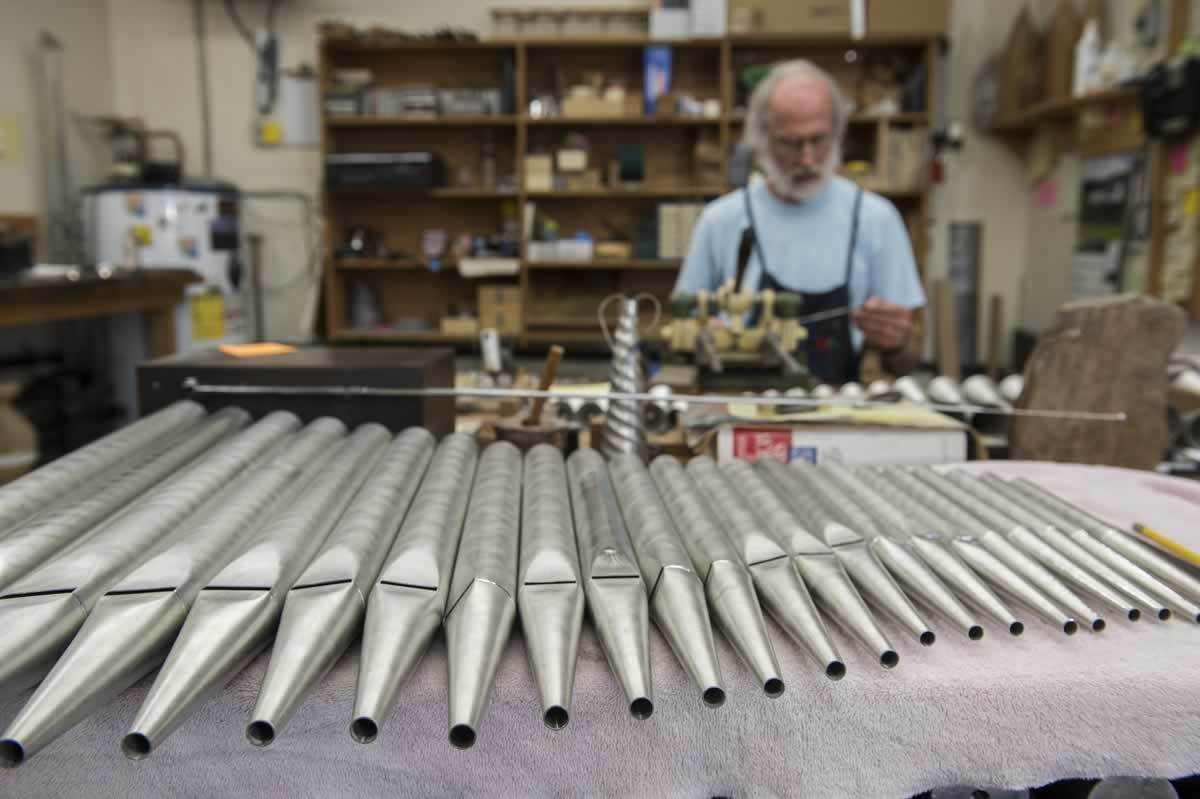 Principal pipes, which sound like no other instrument but a pipe organ, lie completed and washed at Greg Bahnsen's work station.