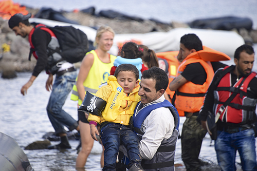 Syrian refugees arrive on Greek island of Lesbos, September 2015, Malcolm Chapman / Shutterstock.com