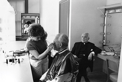 Father Ted watches as Father Ned Joyce, CSC, is prepped for a retirement ceremony in 1987.