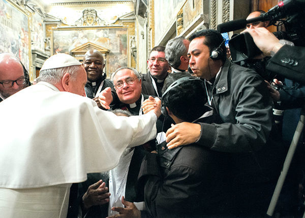 The author, center, meets the Holy Father in the Sala Regia, photo courtesy L'Osservatore Romano