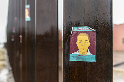 Stickers on the border wall protest the shooting death of 16-year-old Jose Antonio Elena Rodriguez on the Mexican side of Nogales, allegedly by a U.S. Border Patrol agent.
