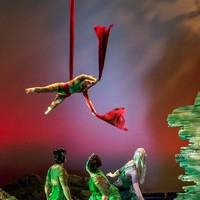 """Hell is empty and all the devils are here!"" Aerialist Sarah Razmann and members of Ariel's Quality swirl and dazzle in a scene from Act I."
