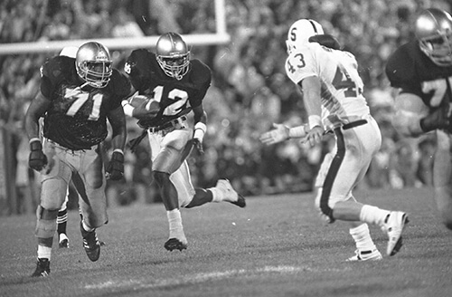 Dean Brown clears a path for Ricky Watters, South Bend Tribune