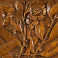 Isaac Scott, an architect, woodcarver and leading craftsmen of the Gilded Age art furniture movement, designed this hand-carved wood panel as the Hanfords' home was being built and furnished in 1883-84. Already a close friend of John and Frances Glessner when he left Chicago for the East Coast in 1883, Scott would return to design furniture for the Glessners' Prairie Avenue home, a noted architectural masterpiece designed by architect H.H. Richardson and completed in 1887. Today visitors to the Glessner House Museum may see the house and its complete period furnishings, which have survived nearly intact and are in the process of being restored, room by room, under the supervision of curator Bill Tyre, who considers Jack Simmerling to have been a friend and mentor.