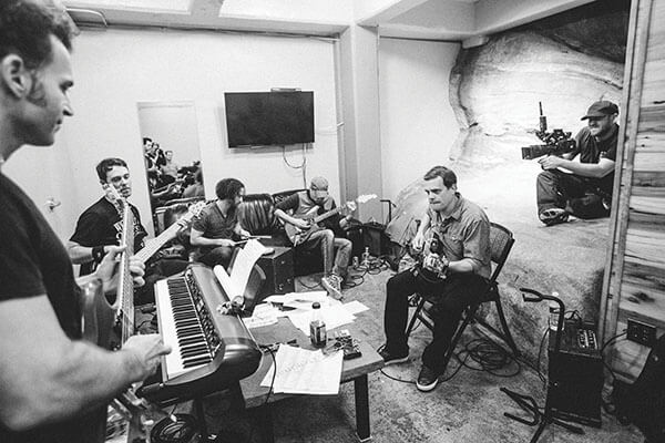 Dweezil Zappa (left), who opened for Umphrey's McGee at Red Rocks, joins the band in the amphitheatre's rehearsal room carved into the mountain, photo by Abby Fox