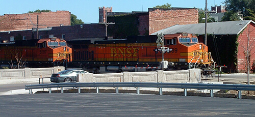 A BNSF locomotive at the Cherry Street crossing, Galesburg, Illinois, 2016, Photo by Kelly Martin, Wikimedia Commons