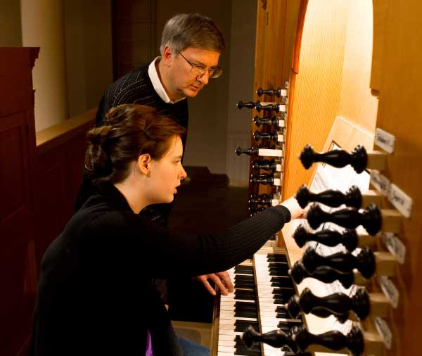 Graduate student Leora Nauta practices with professor Craig Cramer in the Reyes Organ and Choral Hall.
