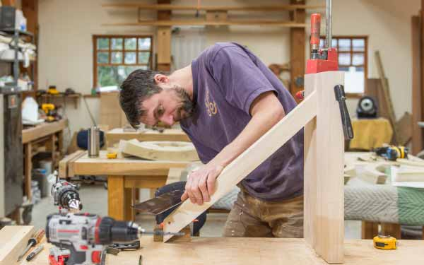 Andreas Schonger shapes one of the rising, curved toeboards that will showcase the Murdy's façade pipes.