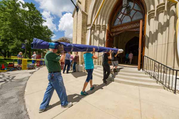 Members of Paul Fritts' crew and Notre Dame volunteers carry parts for the Murdy Family Organ into the Basilica of the Sacred Heart.