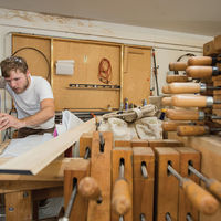 Carpenter Joe Green shapes a piece of the Murdy puzzle at the Fritts workshop, July 2015.
