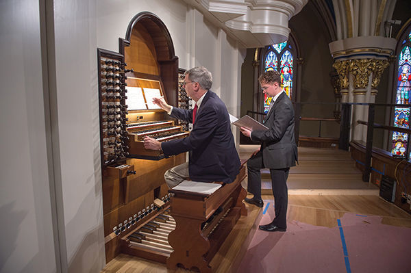 Professor Cramer and student Michael Plagerman are just two of the organists eager to get their hands and feet on the new instrument. photo: Barbara Johnston