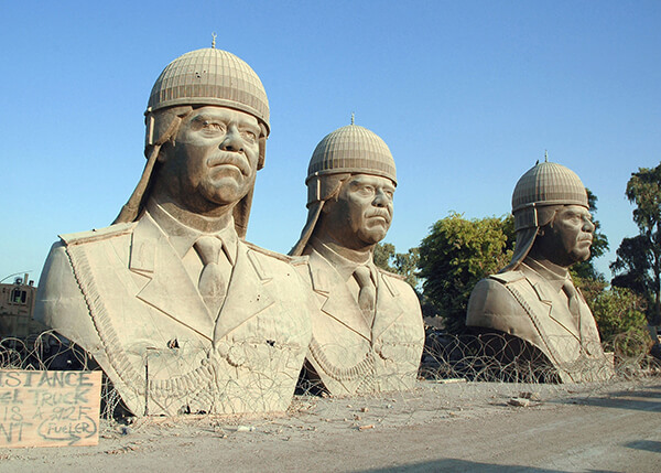 Thirty foot tall sculptures of deposed Iraq president Saddam Hussein sit on the grounds of the former Republican Palace in central Baghdad, 2005.