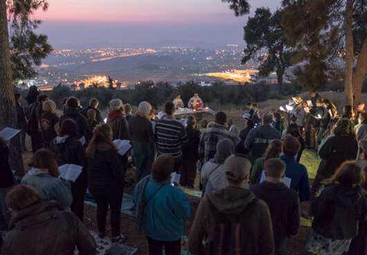 Pastors Carrie and Robert Smith lead an Easter sunrise service on the Mount of Olives for Redeemer Lutheran Church's English-speaking congregation, photo by Ben Gray.