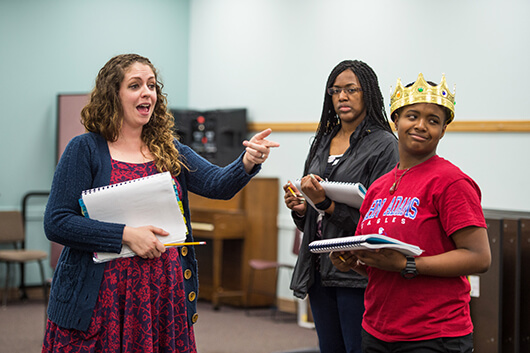 Christy Burgess (left) helps Cameron Pierce (right) and Sha-Nia Clay (center) with their lines, photo by Barbara Johnston