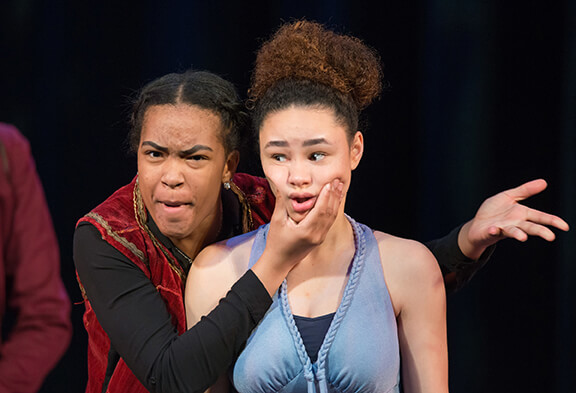 Kennedi Bridges, as Iachimo, wonders who wouldn't love this face? Precious Parker endures the demonstration as Imogen.