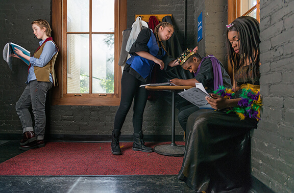 From left: Ophelia Emmons, Ellie Graff, Cameron Pierce and Zion Williams review their scripts backstage at Washington Hall, photos by Barbara Johnston