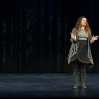 Director Christy Burgess introduces the Robinson Shakespeare Company's production of Cymbeline to a Washington Hall audience.