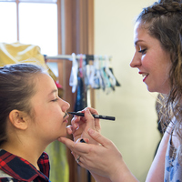 Lizzie Graff is a 12-year-old girl, but she plays the warrior/kidnapper Belarius who lives in a cave with his stolen boys. Director Christy Burgess applies a makeup mustache to help with the transformation.