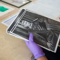Photographs from historic Shakespeare performances were among the artifacts Robinson Shakespeare Company members handled with gloved care.
