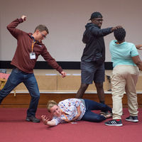Scott Jackson of Shakespeare at Notre Dame and Robinson Shakespeare Company members Grace Lazarz, Josh Crudup and Christian Jackson create a tableau, a still image depicting part of a play, for Julius Caesar.