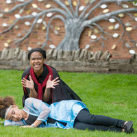Iachimo (Kennedi Bridges) kneels beside a sleeping Imogen (Precious Parker) during a rehearsal of Cymbeline at Shakespeare's New Place in Stratford-upon-Avon, England.