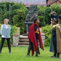 A visitor to Shakespeare's New Place photographs the Robinson Shakespeare Company's rehearsal of Cymbeline.