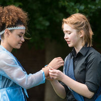 Posthumus (Ophelia Emmons), right, clasps a manacle of love on his wife, Imogen (Precious Parker).