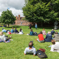 Visitors to Shakespeare's New Place gather in the Great Garden to watch the Robinson Shakespeare Company's performance of Cymbeline.