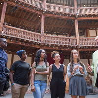 Notre Dame professor Peter Holland, a Shakespeare expert, speaks to members of the Robinson Shakespeare Company at the Globe Theatre in London.
