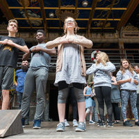 Actors from the Robinson Shakespeare Company participate in a stage movement workshop at the Globe Theatre in London.