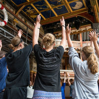Robinson Shakespeare Company members follow the direction of The Globe Theatre's Master of Movement during a workshop on the stage of the iconic playhouse in London.