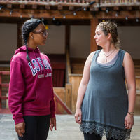 Kennedi Bridges, left, and Christy Burgess make eye contact during an exercise in a workshop with the Master of Movement at Shakespeare's Globe, Glynn MacDonald.