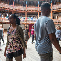 Robinson Shakespeare Company actors stride around the stage at the Globe Theatre in London.