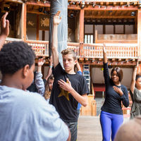 Robinson Shakespeare Company actors learn the principles of stage movement during a workshop at the Globe Theatre in London.