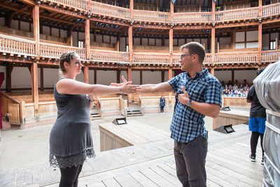 Christy Burgess and Scott Jackson participate in the Robinson Shakespeare Company's movement workshop at Shakespeare's Globe.