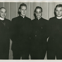<p>Back at Notre Dame in April 1945 after more than three years in confinement are (left to right) Brother Theodore Kapes, CSC, Brother Rex Hennel, CSC, Father Jerome Lawyer, CSC, '35 and Father Robert McKee, CSC, '36. Photograph from the Archives of the University of Notre Dame, Notre Dame, Indiana.</p>