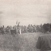 "<p>Father Barry says Mass in an Italian field after the bitter fighting at Anzio. ""A Mass of Thanksgiving after returning from battle,"" Father Barry wrote on the back. ""These gallant lads are a credit to their faith."" Photo courtesy Holy Cross Archives.</p>"