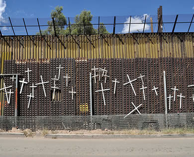 Crosses on the border wall at Nogales, Arizona, photo by Jonathan McIntosh