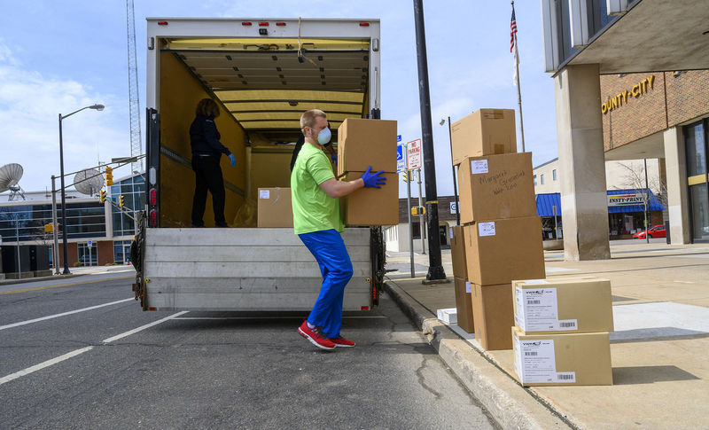Worker unloads boxes of donated protective gear