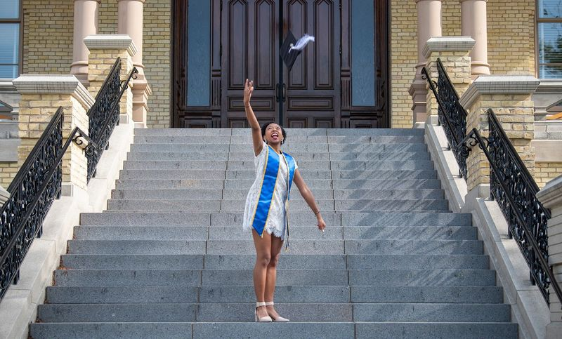 Grad Senior On Main Building Steps