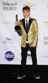 Justin Bieber photo by Kristian Dowling/Picturegroup via AP Images