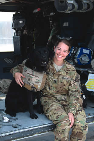 Hayden Piscal Howell and Zeke, a combat stress dog