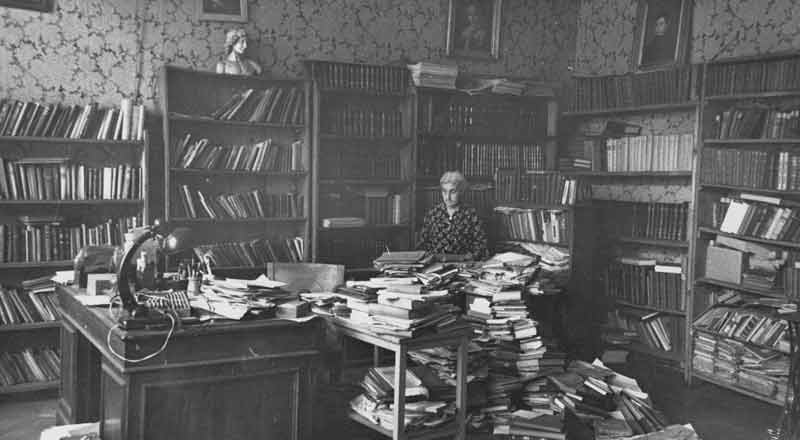 Rusudana, ca. 1970, in the family apartment in Tbilisi, surrounded by her library and archive.